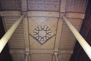 the intricate wood work on the ceiling